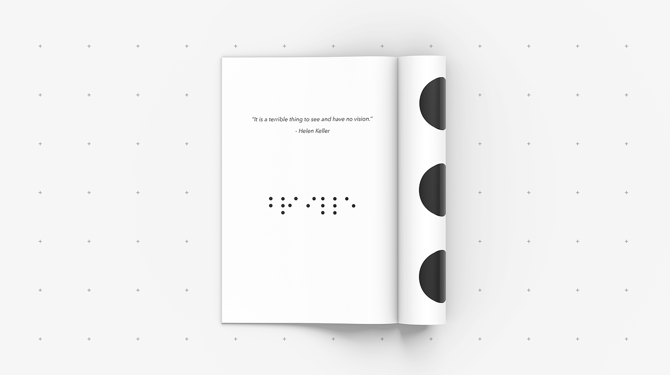 """A mockup of a book sits on a gray, dotted background. On the first page, a quote by Hellen Keller reads: """"It is a terrible thing to see and have no vision."""" Below that, the word """"Braille"""" is written in the Braille alphabet. On the second page, part of the Braille grid is shown."""