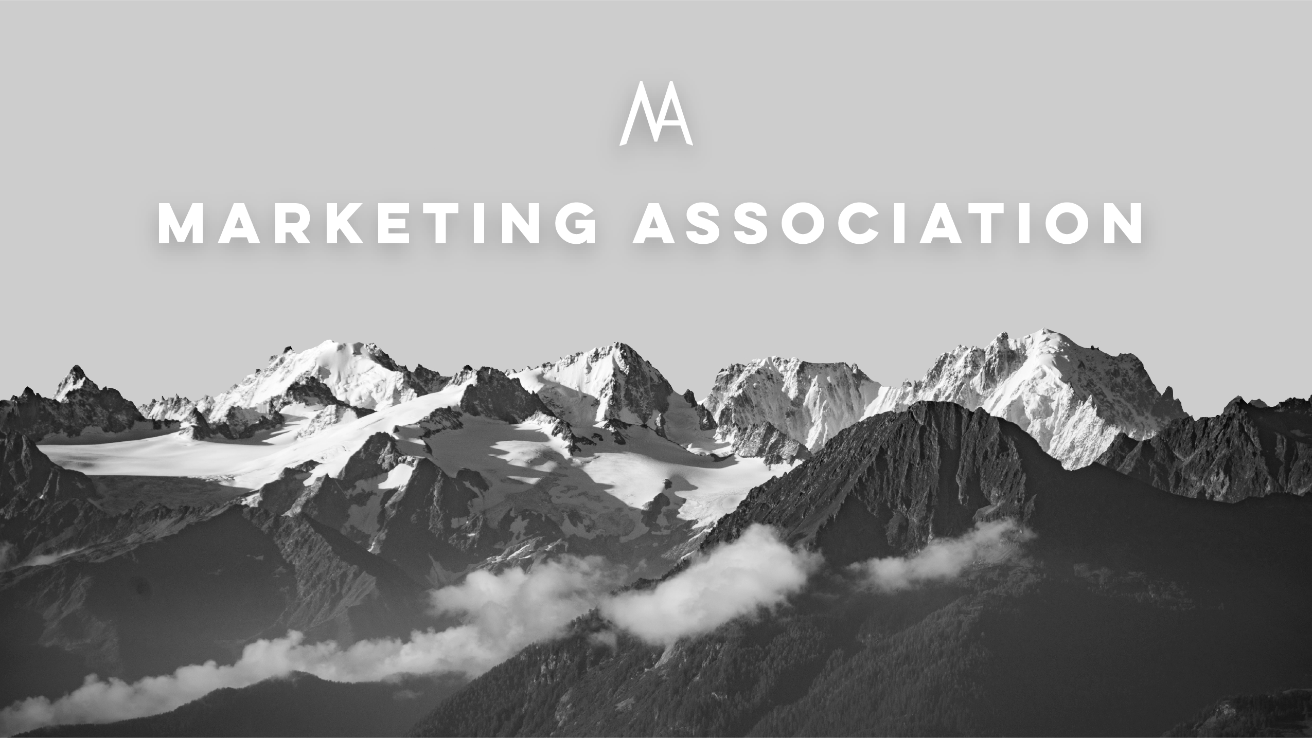 """MA Banner — A monochrome image of a mountain range. On top of it, the words """"Marketing Association"""" and the organization's logo are placed on top in white, with a subtle drop shadow."""